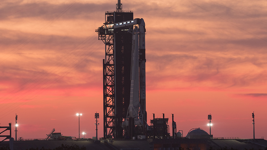 The SpaceX Crew Dragon Endeavour sits atop the Falcon 9 rocket during a sunset at the Kennedy Space Center in Florida. Credit: NASA/Joel Kowsky