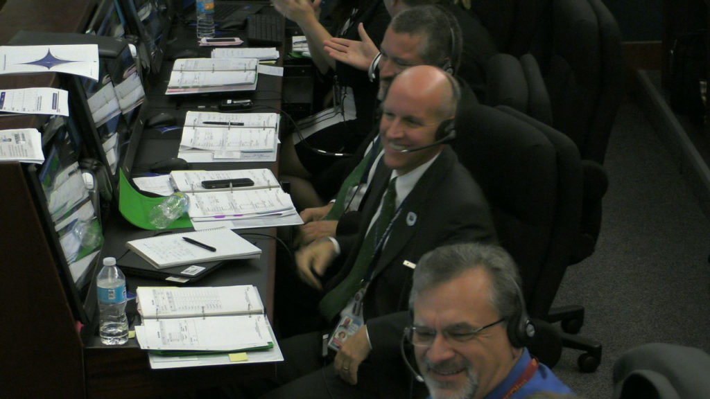All smiles in the Mission Director's Center following successful deployment of all eight CYGNSS observatories.