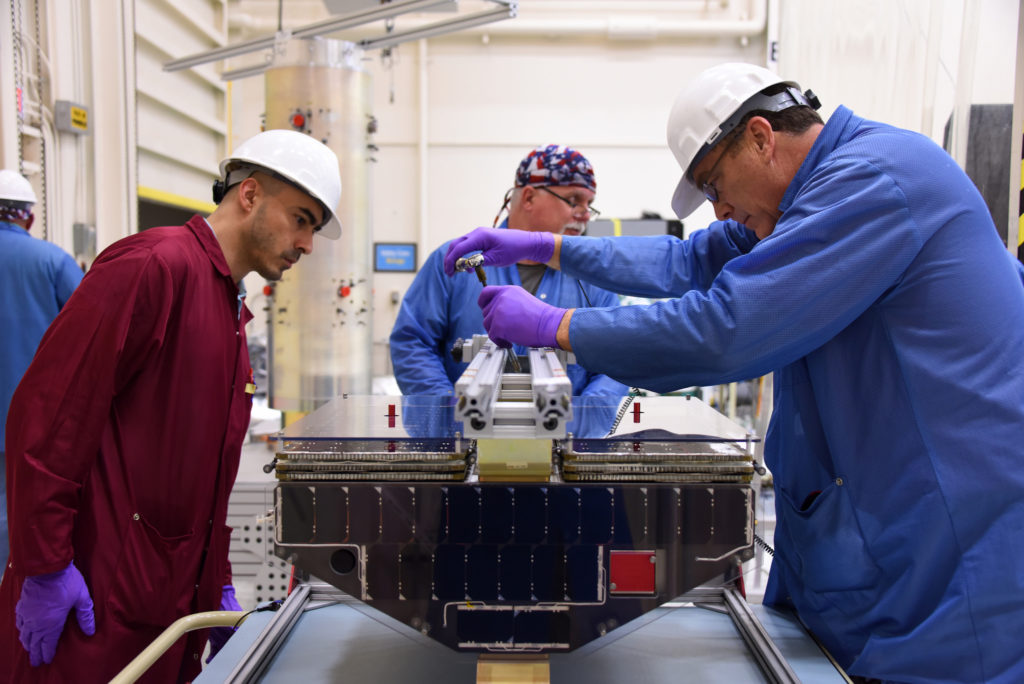 Technicians with Orbital ATK prepare one of the CYGNSS microsatellites for installation on the deployment module at Vandenberg Air Force Base in California in October 2016.