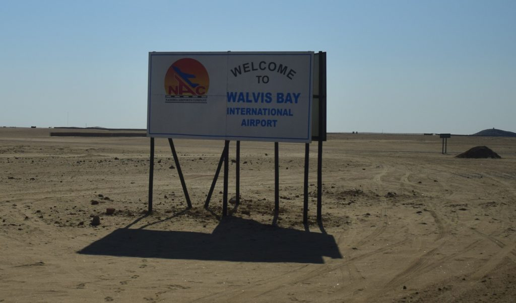 Sign for Walvis Bay Airport which is off in the distance toward that hill in the top left. Credit: NASA/Jane Peterson