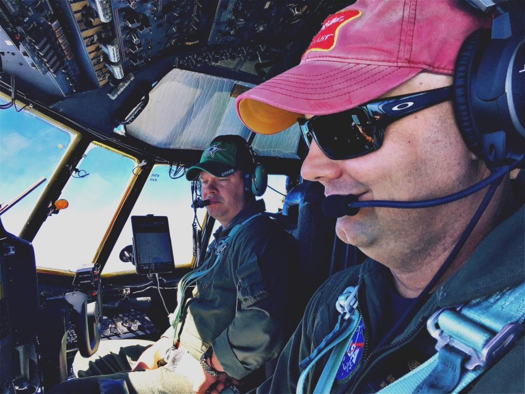Pilots Brian Bernth, foreground, and Jeff Callaghan maneuver the C-130 to altitudes from 1,000 to 25,000 feet. Twice during the 5-hour flight, they push the aircraft into long, looping spirals that start high and end with turbulent low-altitude runs. Credit: NASA/Joe Atkinson