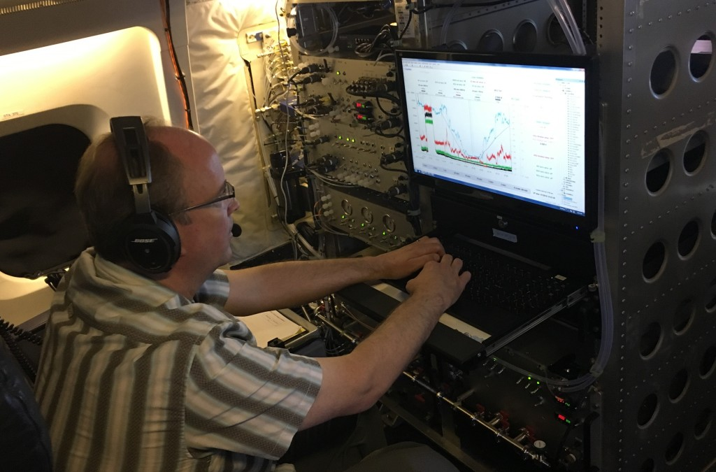 NOAA's Tom Ryerson is glued to his computer screen for much of the flight, watching data stream in from his Nitrogen Oxides and Ozone instrument. Credit: NASA/Samson Reiny
