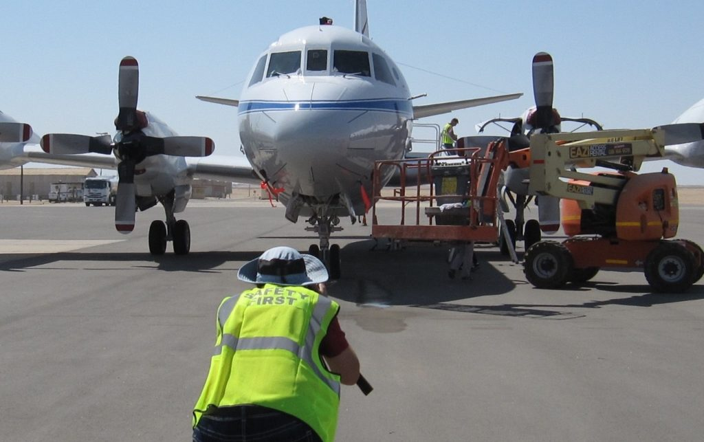 NASA photographer Jane Peterson on the tarmac in Walvis Bay, Namibia.