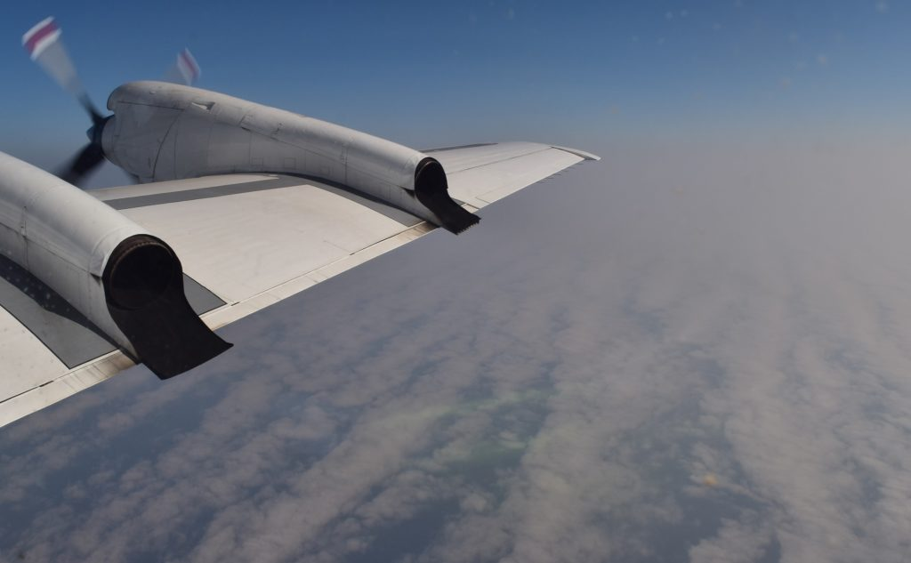 NASA's P-3 flies above clouds over the southeast Atlantic ocean to study their interactions with smoke. Credit: NASA/Jane Peterson