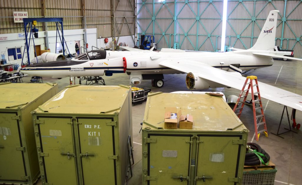The ER-2 in the hangar at Walvis Bay Airport. The pod under the visible wing is open where a science instrument is installed. Credit: NASA/Jane Peterson