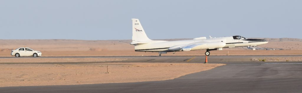 NASA's ER-2 lands at Walvis Bay Airport, Namibia. Behind it is the chase car driven by the second ER-2 pilot with a radio to be an extra pair of eyes for landing. Credit: NASA/Brian Rheingans