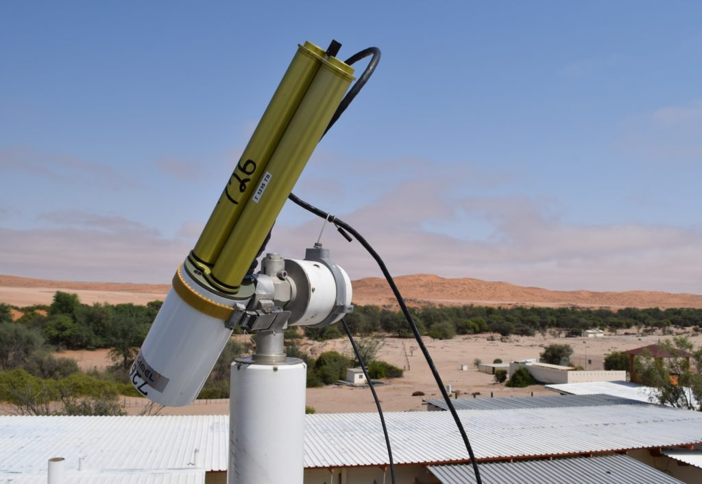 "The AERONET sun photometer at Gobabeb points at the sun and measures the light energy that reaches it. Since scientists know how much energy the sun produces at the top of the atmosphere, any difference measured by the instrument at the ground is caused by ""stuff"" – aerosols like smoke, dust, and sea salt – between the top of the atmosphere and the ground. From that scientists can calculate aerosol concentrations in the atmosphere. Credit: NASA/Jane Peterson"