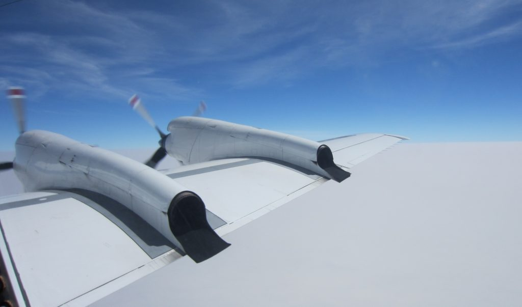 P-3 flying above stratocumulus clouds and under wispy cirrus clouds above. Credit: NASA/David Noone