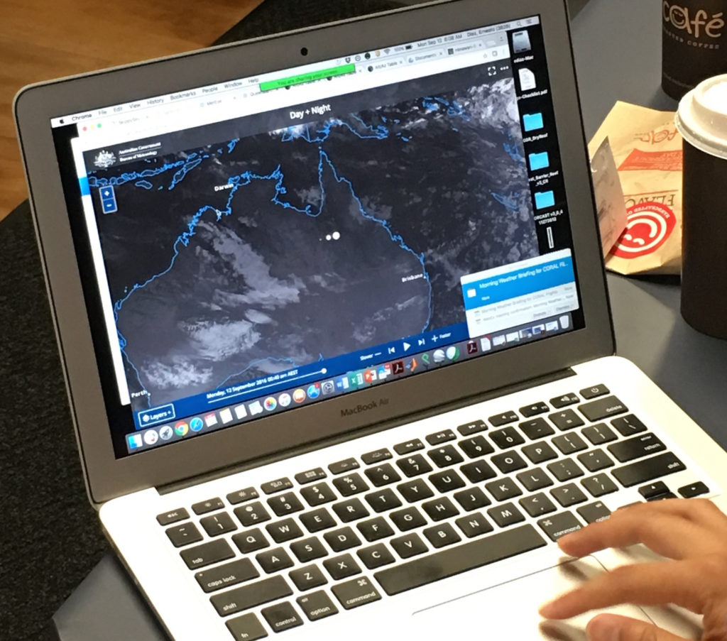 Ernesto Diaz looks to weather forecasts from the Australian Bureau of Meteorology to determine if a CORAL flight will happen on any given day. Credit: NASA/Alan Buis