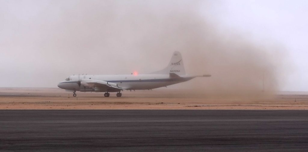 A cloud of fine sand billows up as the P-3 moved down the runway at the Walvis Bay Airport. Credit: NASA/Jane Peterson