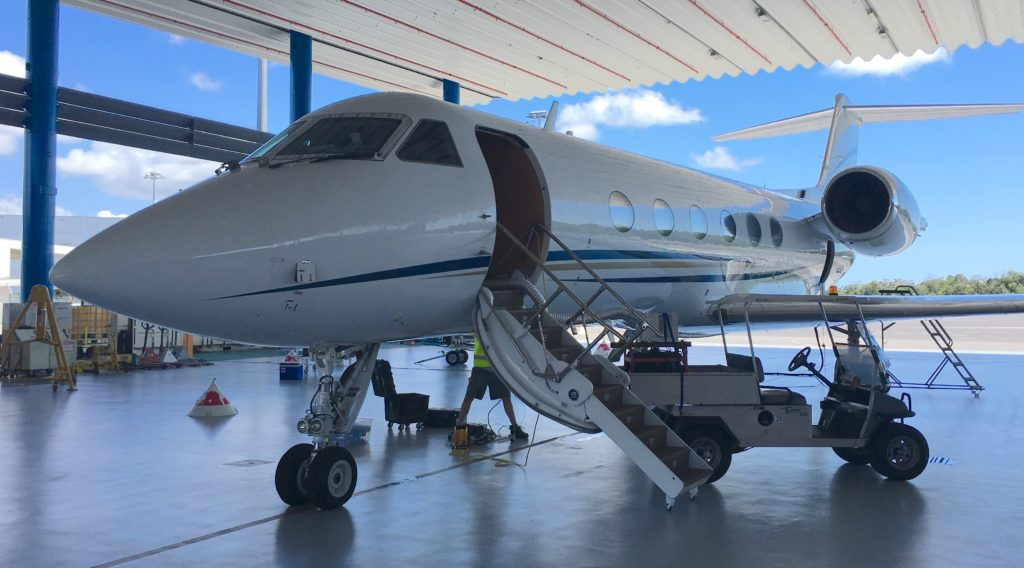 The Gulfstream IV plane carrying CORAL's Portable Remote Imaging Spectrometer (PRISM) instrument sits in Hawker Pacific's hangar at Cairns Airport.