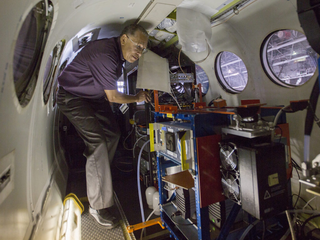 Charles Howell, electronics engineer, makes final adjustments to the electrical system of NASA's King Air B-200 at Langley Research Center in Hampton, Virginia. Credit: NASA/David C. Bowman