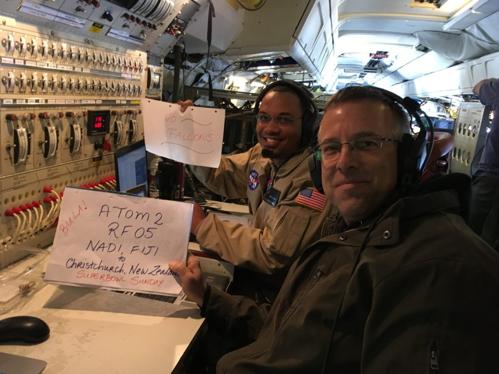 Mission manager Tim Moes and Operations Engineer Matt Berry support the Falcons aboard NASA's DC-8 flying laboratory on the ATom flight leg from Fiji to New Zealand, Feb. 6, 2017. Credit: NASA/Ellen Gray