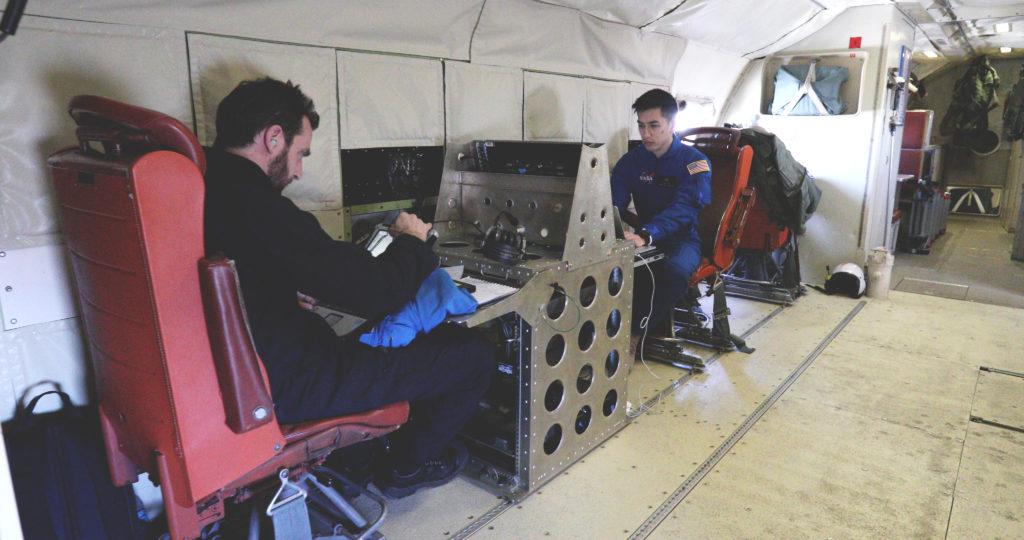 Scientists Alex Coccia (left) and Albert Wu during a SnowEx science flight over Colorado. Credit: NASA/Joy Ng