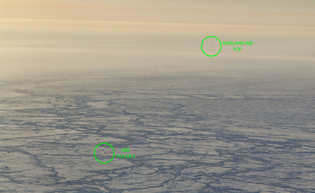 View from the P-3's cockpit of the encounter with the Polar 5 and Twin Otter planes. Credit: NASA/Jeremy Harbeck