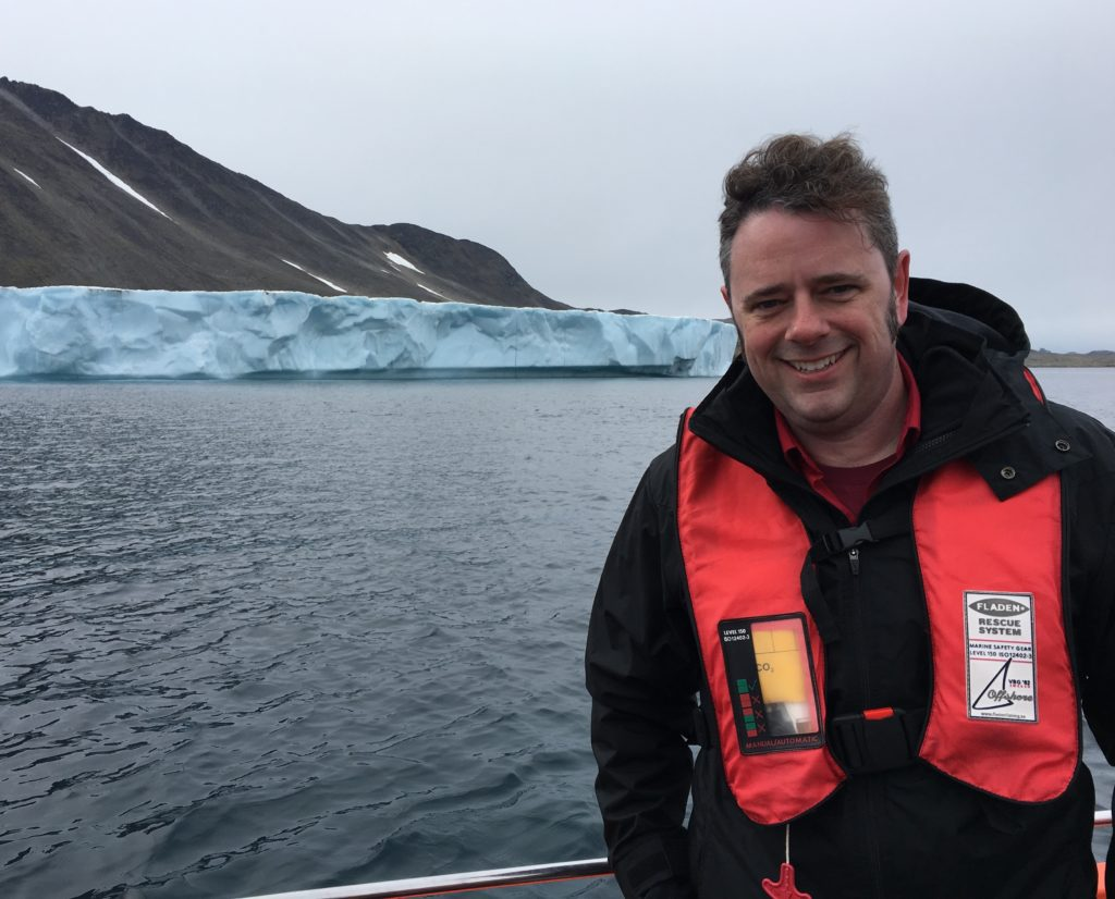 Josh Willis, OMG's principal investigator, on approachby boat to Apusiaajik glacier in Greenland. Credit NASA/JPL-Caltech