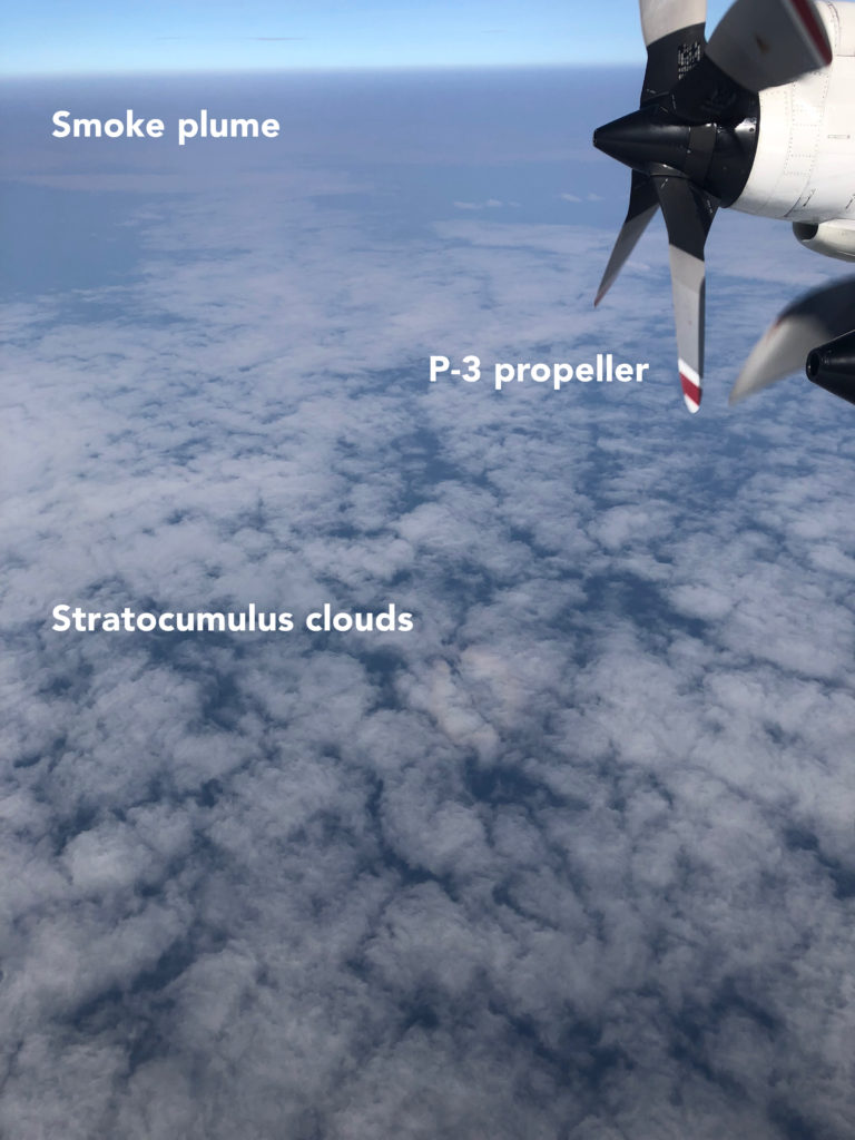 Image 2: View of smoke produced by fires in southern Africa over low-lying clouds in the southeast Atlantic Ocean from onboard the P-3 during the October 10th, 2018, ORACLES flight. Photo credit: Michael Diamond