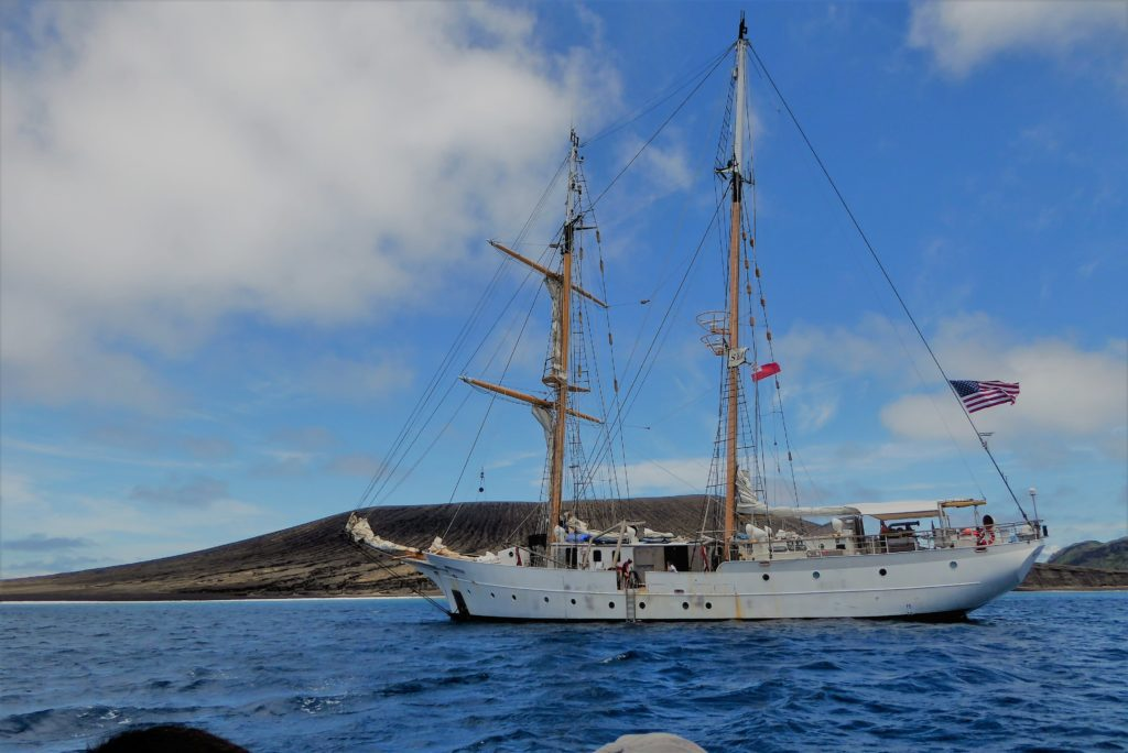 The SSV Robert C. Seamans of Woods Hole's SEA Semester program at Hunga Tonga-Hunga Ha'apai. Credit: Dan Slayback