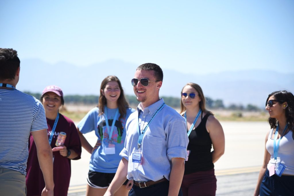 Corey interacts with fellow SARP interns on the flightline at NASA's Armstrong Flight Researcher Center's facility in Palmdale, California. Credits: NASA / Megan Schill