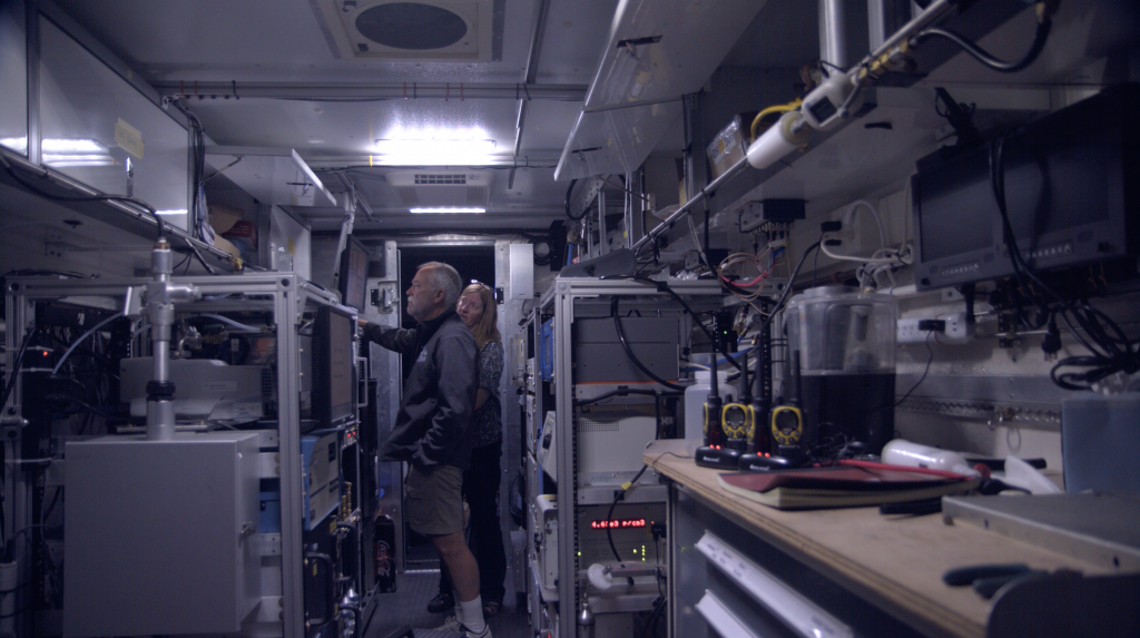 Bruce and Carolyn look at initial readings of gases inside the van. July 24, 2019. Credit: NASA