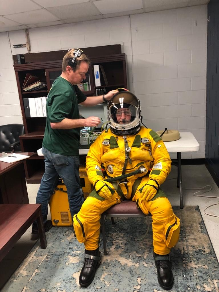 Three hours before takeoff at Hunter Army Air Field in Savannah, Georgia, ER-2 pilot Cory Bartholomew was helped into his full-pressure suit and breathed pure oxygen to help remove nitrogen from his bloodstream. This process prevents decompression sickness at high-altitudes. Credit: NASA/Katie Stern