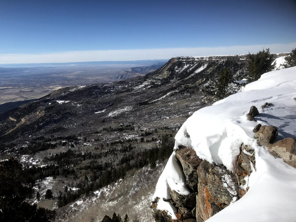 Grand Mesa, Colorado has an elevation of 10,500 feet, and from the Land's End Observatory, you can see across the valley to Utah. The large, flat surface of the mesa is perfect for SnowEx 2020's instrument testing and validation activities. Credit: NASA / Jessica Merzdorf