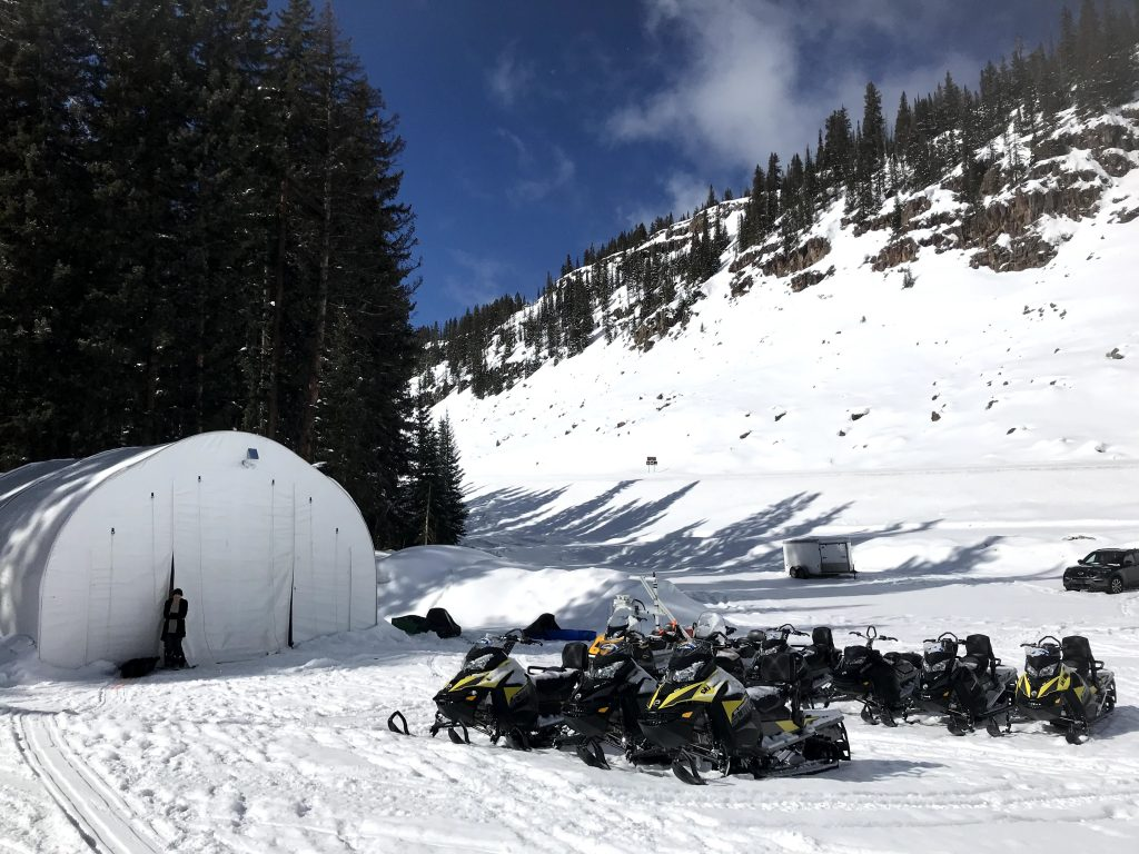 The SnowEx team reached the field sites via daily snowmobile trips. The ride is bumpy and can take 45 minutes to 2 hours, depending on where they're working on the mesa. They towed their instruments and gear on sleds behind the snowmobiles. Credit: NASA / Jessica Merzdorf