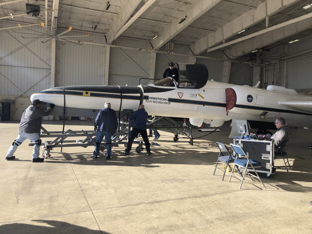 NASA ground crew preparing the ER-2 for a science flight at Hunter Army Airfield in Savannah, Georgia. There are seven scientific instruments located on the aircraft for the IMPACTS project and they are used to study snowstorms. Credit: NASA/Katie Stern
