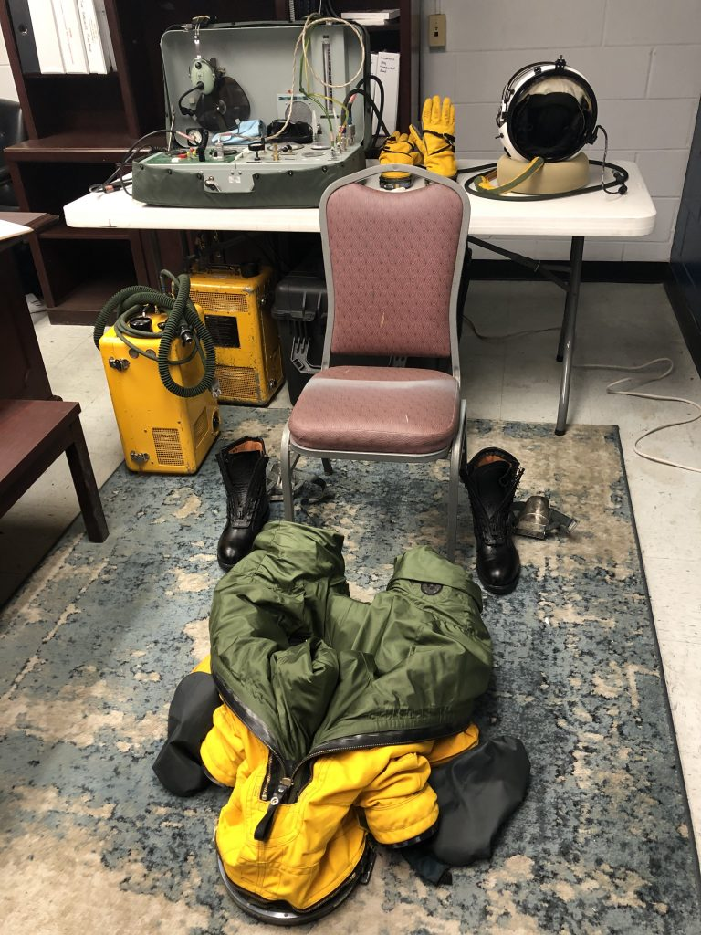 Prior to every flight, the ER-2 Life Support team lays out all of the equipment to aid in an easier suiting up process. The suits weigh between 35-40 pounds and every pilot wears long underwear inside the suit. It is important to make sure that the pilot does not overheat during the suiting process so the pilots are usually assisted by a Life Support crew member. Credit: NASA/Katie Stern