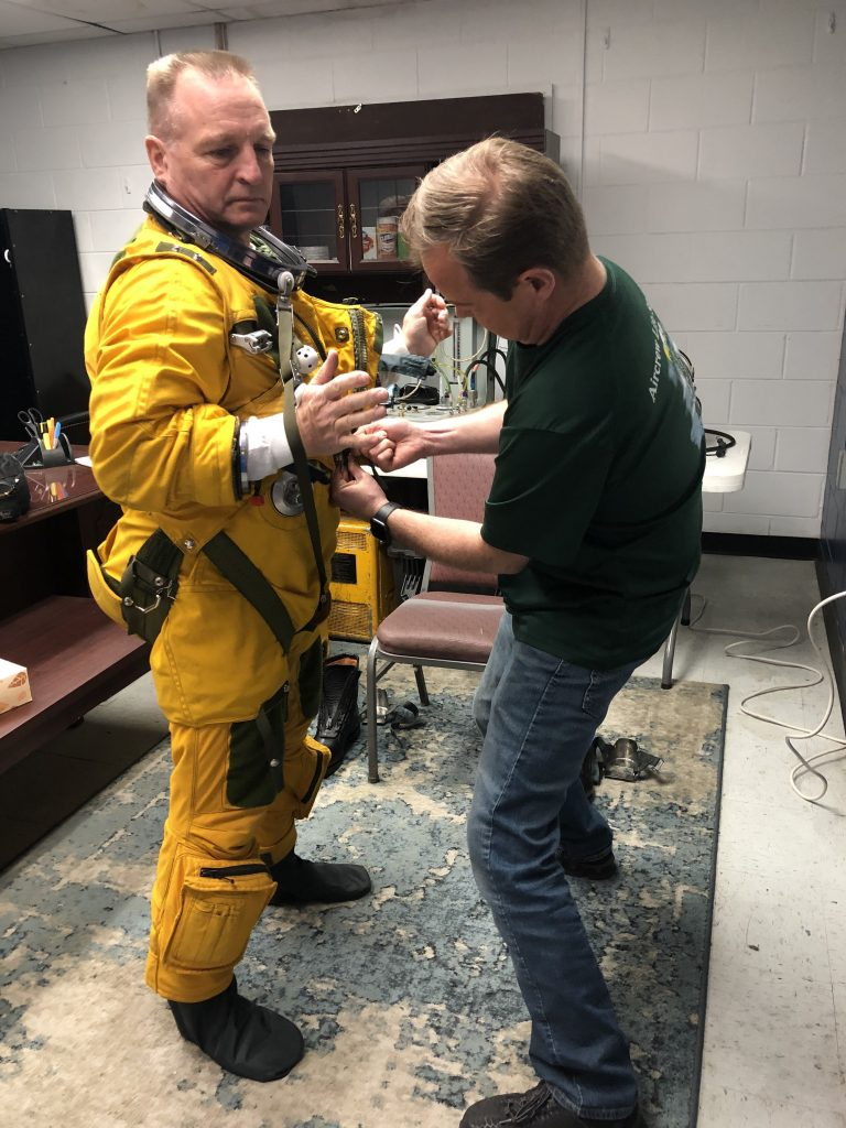 ER-2 Pilot Cory Bartholomew being helped into his full pressure suit by Joey Barr from the Life Support Team. Credit: NASA/Katie Stern