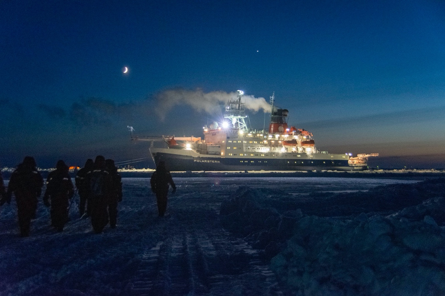The German icebreaker Polarstern lit up on every deck, acting as a beacon for researchers navigating the Arctic terrain. Credit: University of Maryland / Steven Fons