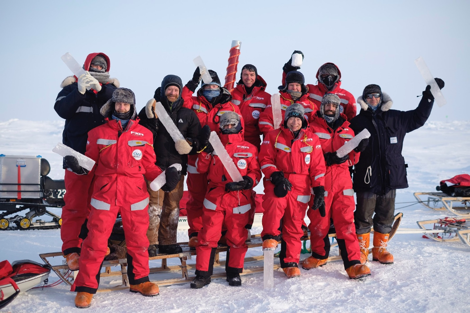 Steven Fons (bottom row, second from the right) and his ice coring team after successfully drilling sea ice samples. Each core will be analyzed at the labs aboard Polarstern. Credit: University Center in Svalbard / Calle Schönning