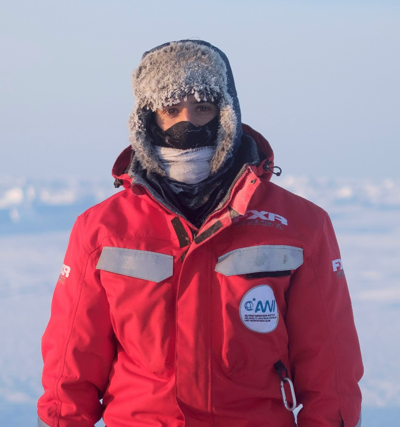 Steven Fons bundles up in the subzero temperatures with a fur-lined hat, multiple face-coverings, and nine or ten layers underneath his protective jacket. Credit: University Center in Svalbard / Calle Schönning