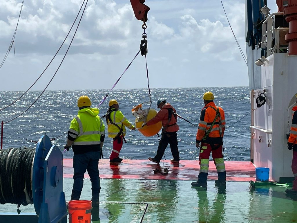Deployment of the Wire Walker, an instrument that sampled up and down the water column while drifting with the currents and generating its power by waves.  Credit: Deborah Steinberg