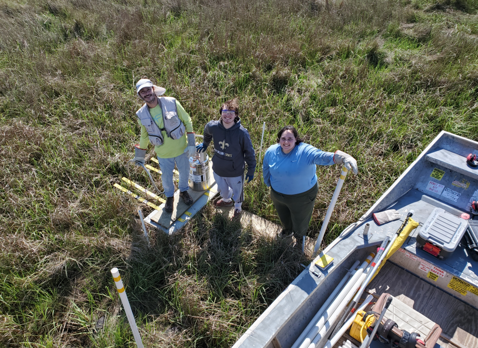 LSU team (Andre, Brandon, Amanda) measuring accretion at their feldspar marker horizon station in coastal Louisiana for NASA's Delta-X