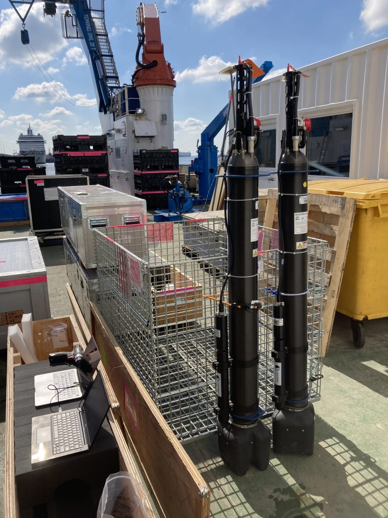 Two BioArgo floats running through post-shipment checks on the deck of the RRS Discovery. Credit: Shawnee Traylor, MIT/Woods Hole Oceanographic Institution
