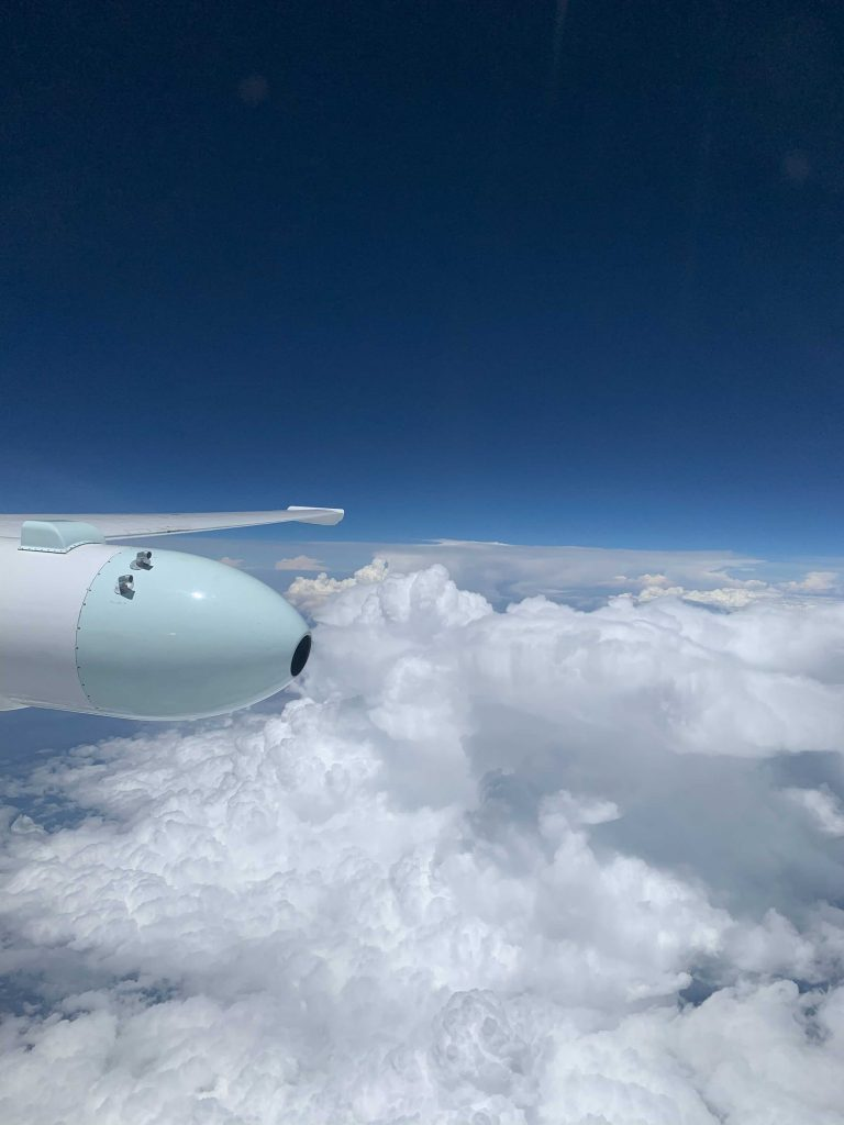 Clouds under a blue sky in the stratosphere, taken from the window of the ER-2