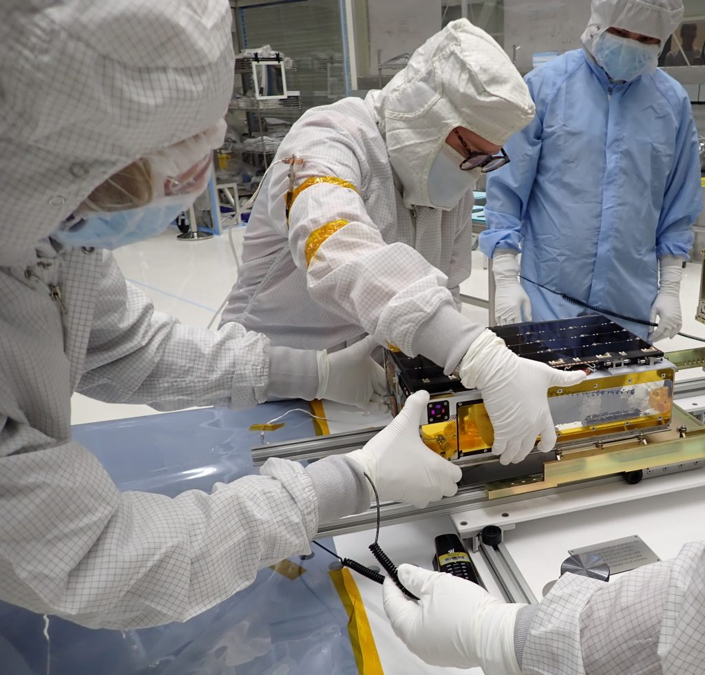 University of Colorado graduate student Arika Egan leads installation of the CUTE CubeSat into the EFS dispenser system at Vandenberg Space Force Base on July 23, 2021. Credit: NASA / WFF