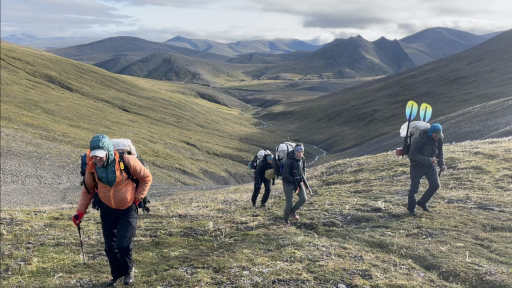 To better understand impacts of climate change on vegetation in the Alaskan Arctic, a group of researchers are linking long-term NASA satellite observations with ecological field data collected while trekking through the Brooks Range in northern Alaska. Photo by Roman Dial.