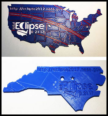 Two 3-D printed pinhole projectors, one in the shape of the continental U.S. and the other shaped like North Carolina