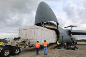 NOAA's GOES-S is offloaded from a C-5 transport aircraft onto the flatbed of a heavy-lift truck at the Shuttle Landing Facility at NASA's Kennedy Space Center in Florida.