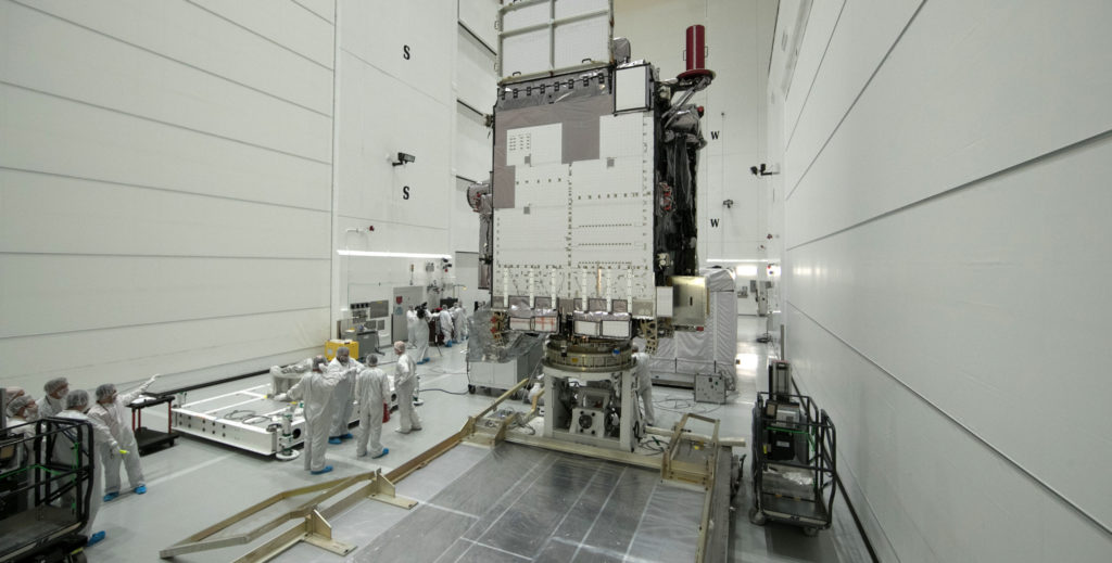 At Astrotech Space Operations in Titusville, Florida, technicians and engineers prepare to begin preflight processing of NOAA's GOES-S after removal from its shipping container.