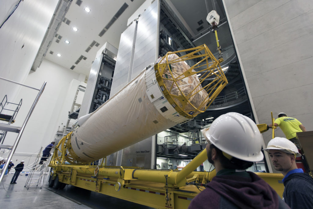 Under the watchful eyes of technicians and engineers, the Centaur upper stage that will help launch NOAA's Geostationary Operational Environmental Satellite-S, or GOES-S, is lifted from its transporter inside the Delta Operations Center at Cape Canaveral Air Force Station for further processing.