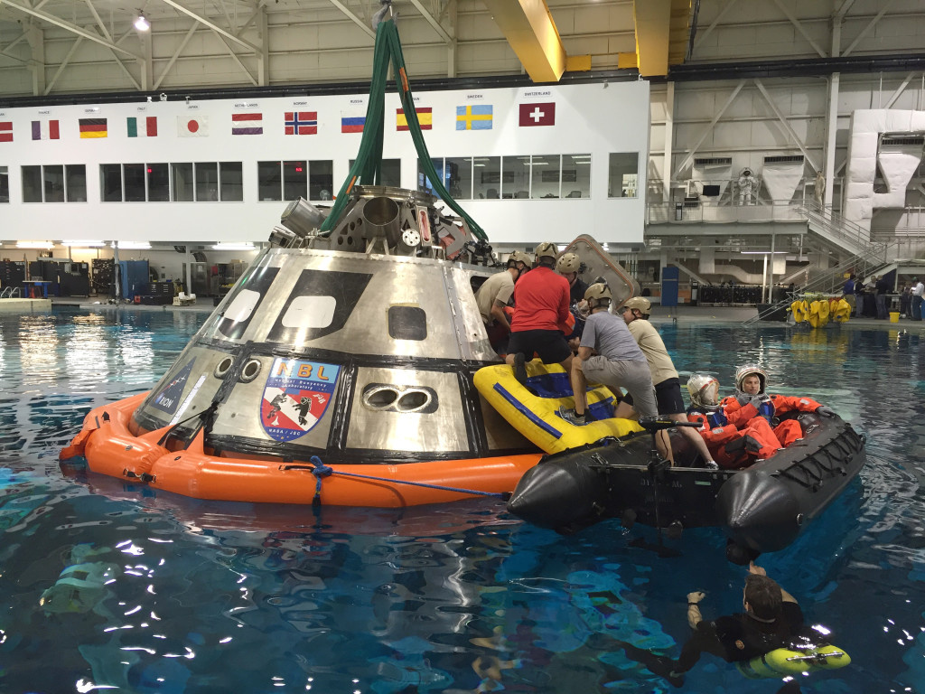 Team members from NASA's Orion and the Ground Systems Development and Operations (GSDO) Program practice egress training Oct. 6-8 using a mockup of the Orion crew module in the 6.2-million-gallon Neutral Buoyancy Laboratory at the agency's Johnson Space Center in Houston. Photo credit: NASA