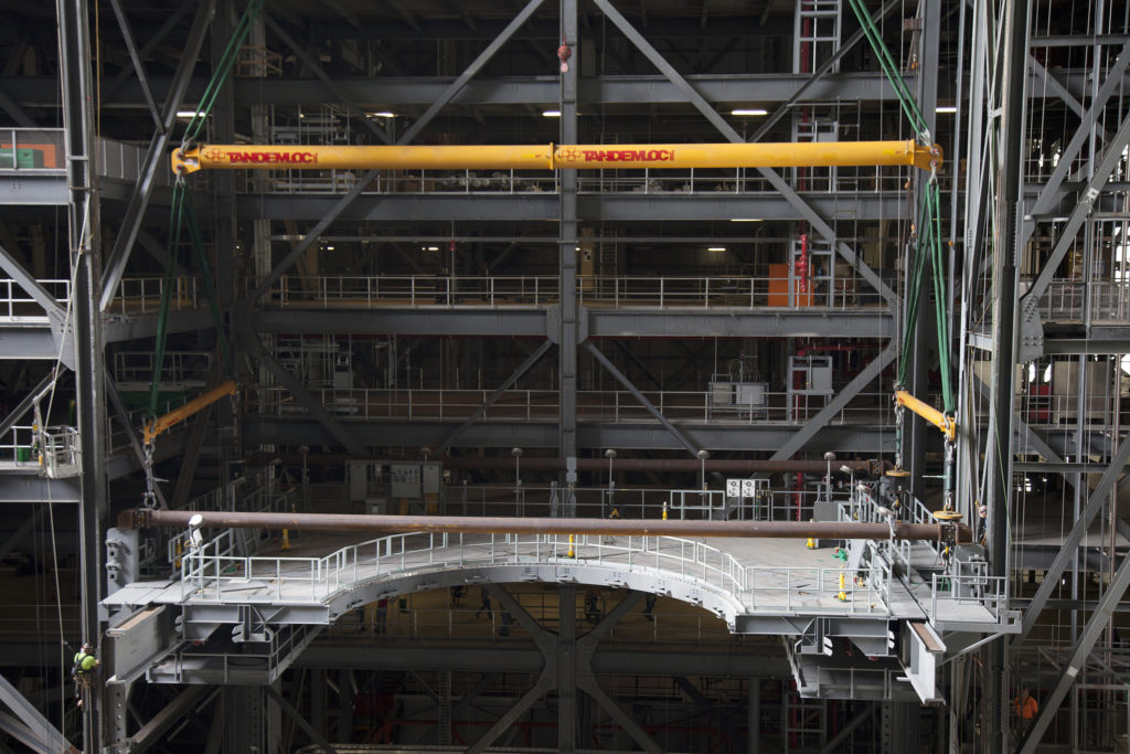 Work Platform E South is lifted and installed in High Bay 3 in the Vehicle Assembly Building.