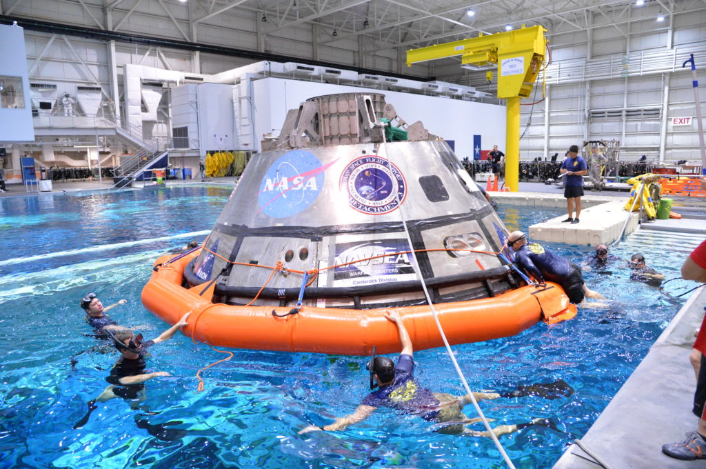 Divers train for Orion underway recovery in the Neutral Buoyancy Lab at NASA's Johnson Space Center in Houston.