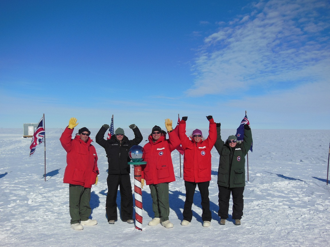 Team members posing at South Pole