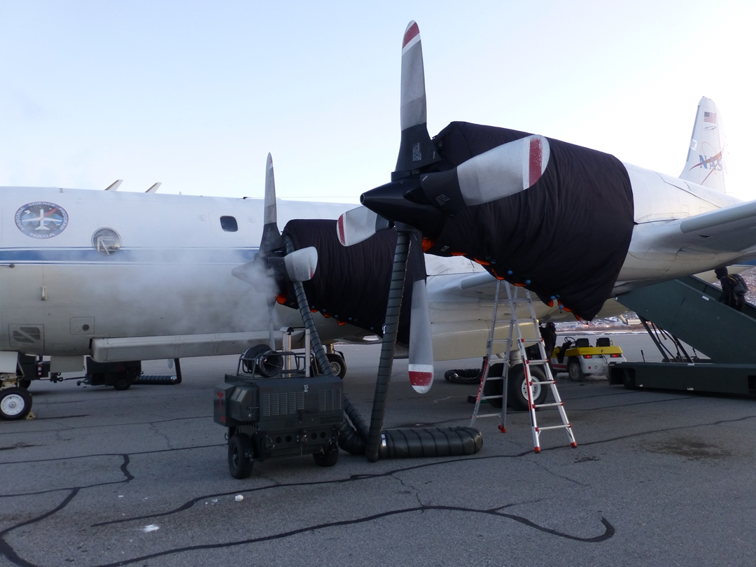 Movable heater warming up P-3 engines