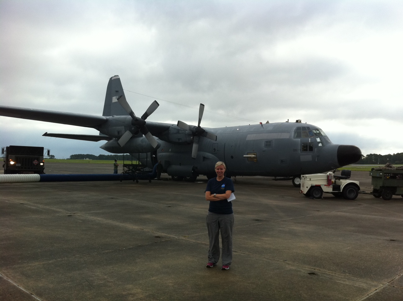 Christy Hansen in front of NASA C-130