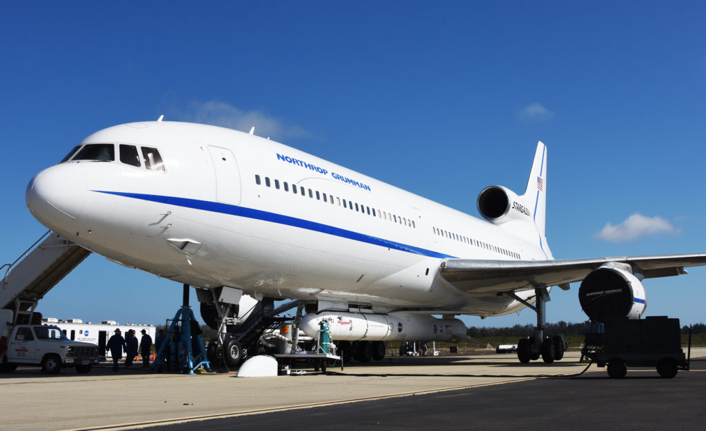 Northrop Grumman's L-1011 Stargazer is being readied on Oct. 14, 2018, at the Vandenberg Air Force Base hot pad. The company's Pegasus XL rocket, containing NASA's Ionospheric Connection Explorer, or ICON, is attached beneath the aircraft. Photo credit: USAF 30th Space Wing/Tony Vaulcin
